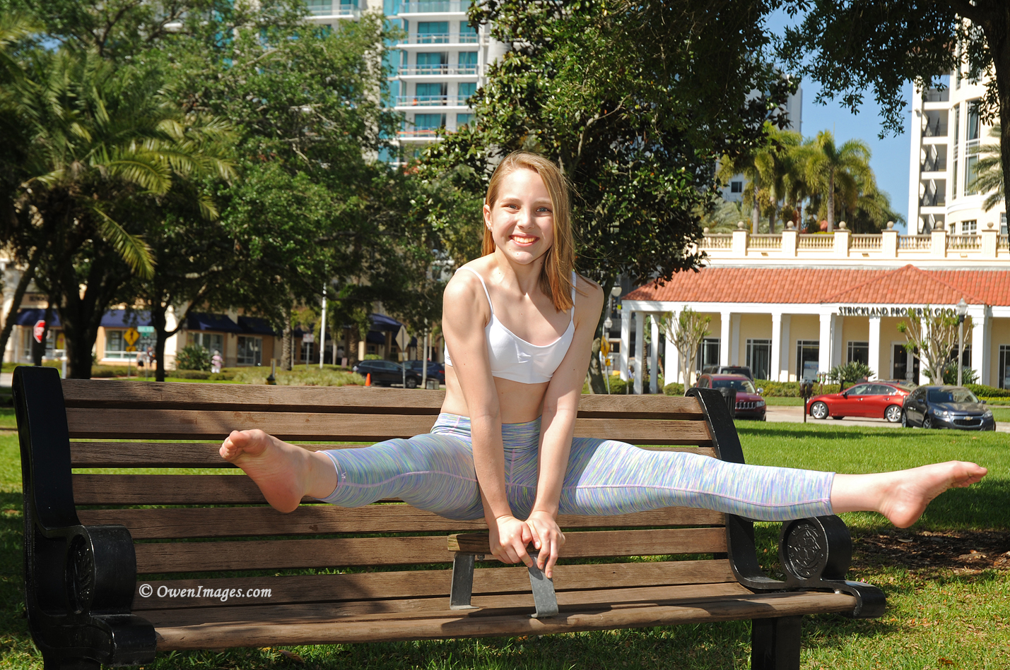 Gymnast pressing up on a park bench in downtown St Petersburg, Florida