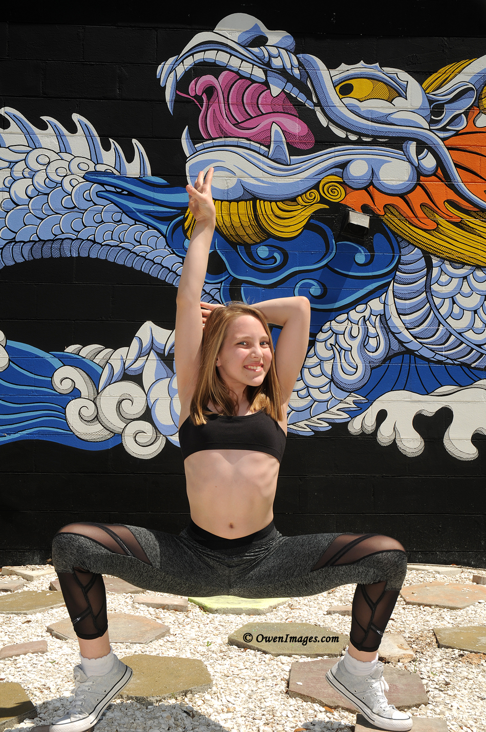 Gymnast posing in front of a mural in downtown Saint Petersburg, Florida