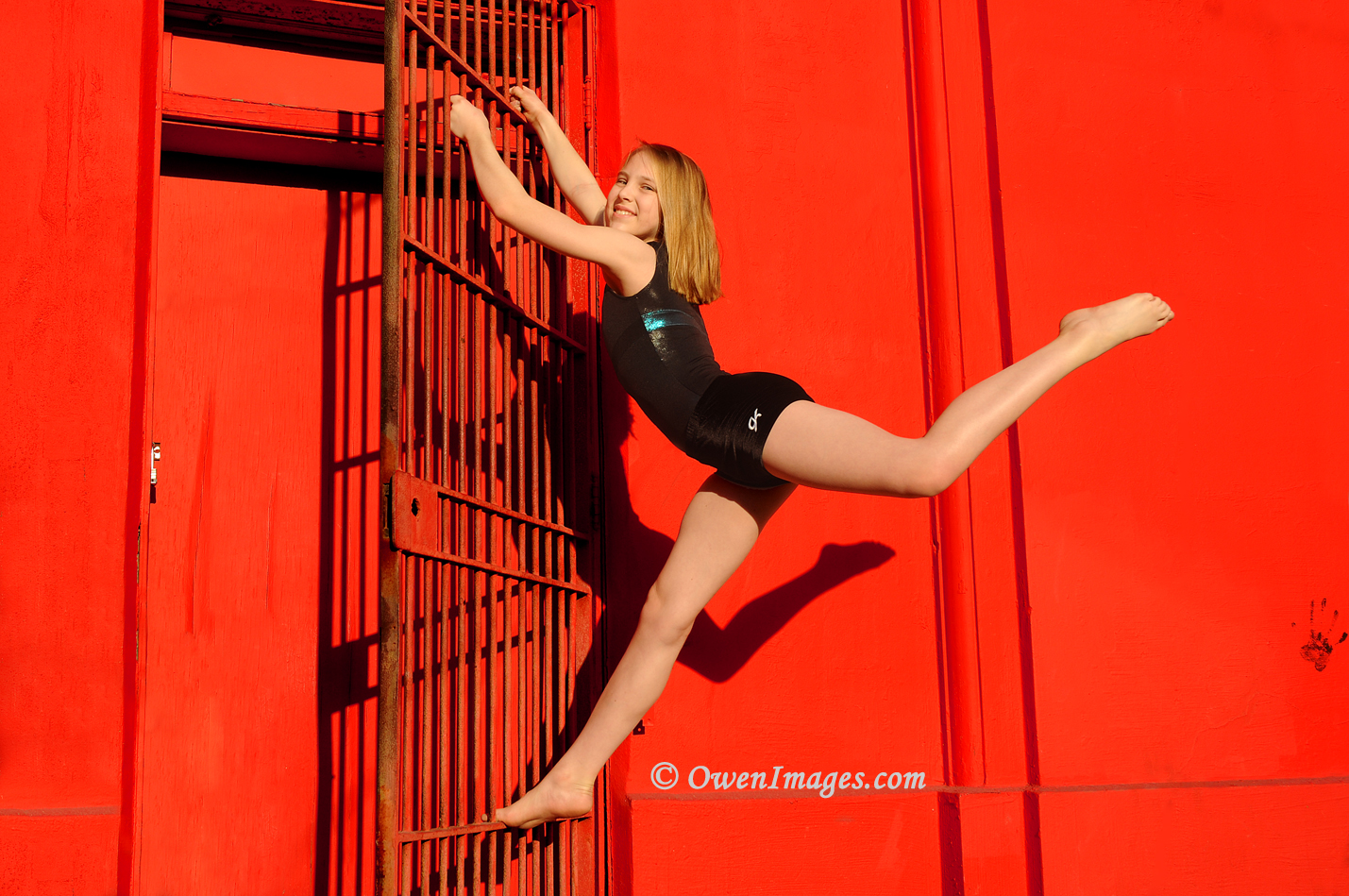 Gymnast against a red wall in downtown St Petersburg, Florida