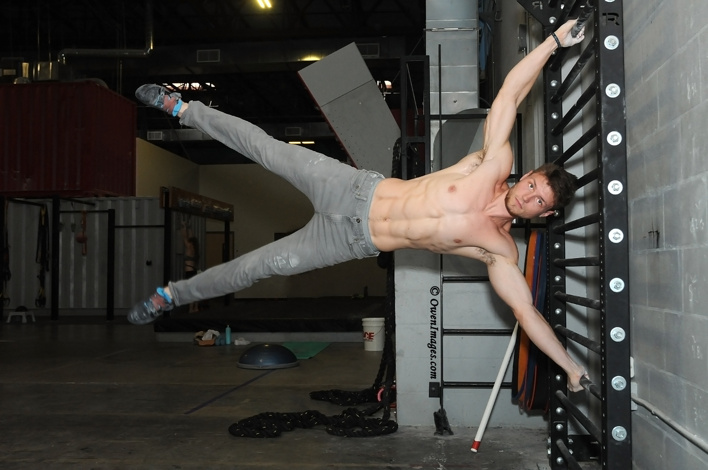 Ethan Surprenant photographed in the gym performing a Starfish Flag. @OwenImages